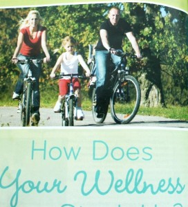 A Newsweek magazine ad sponsored by Amway Global and the YMCA was meant to promote wellness. The family featured in the ad photo is not wearing bike helmets.
