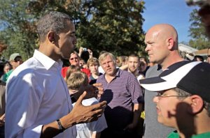 Democratic presidential candidate, Sen. Barack Obama, D-Ill., left, answers a question from plumber Joe Wurzelbacher in Holland, Ohio, Sunday, Oct. 12, 2008. (AP Photo/Jae C. Hong)