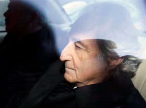 Disgraced financier Bernard Madoff, right, leaves U.S. District Court in Manhattan after a bail hearing Monday, Jan. 5, 2009. Prosecutors said Madoff violated bail conditions by mailing about $1 million worth of jewelry and other assets to relatives and should be jailed without bail. Photo: Associated Press