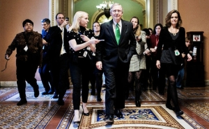 U.S. Senate Minority Leader Mitch McConnell (R-KY) leaves the Senate Chamber early Tuesday. Photo: New York Times