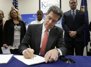 Kansas Gov. Sam Brownback signed into law a bill allowing people to carry  concealed weapons into public buildings, including college campuses in the state.