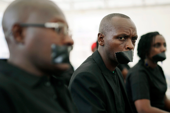 Journalists with tape over their mouths gather on World Press Freedom Day in Bujumbura, Burundi last May. They denounced attacks on and threats to journalists, media workers and human rights defenders in Burundi. PHOTO: AP/Jerome Delay