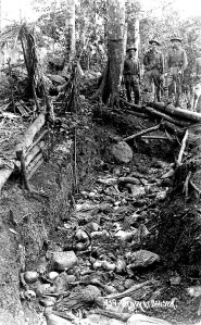 American soldiers stand near one of the trenches where Moro warriors fought to the death in the 1913 Bud Bagsak battle. Photo: Library of Congress